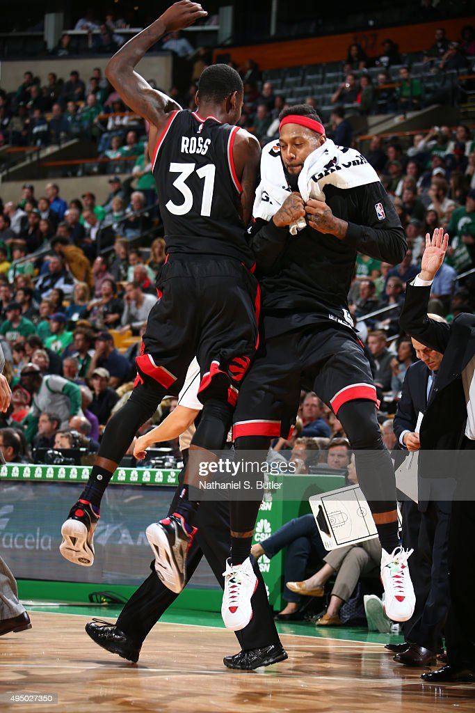 Teammates Terrence Ross #31 and James Johnson #3 of the Toronto Raptors react during a game against the Boston Celtics on October 30, 2015 at TD Garden in Boston, Massachusetts.