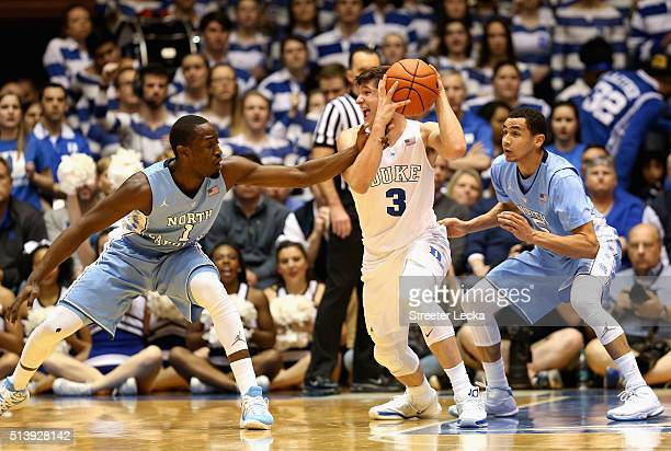 Teammates Theo Pinson and Marcus Paige of the North Carolina Tar Heels try to stop Grayson Allen of the Duke Blue Devils during their game at Cameron...