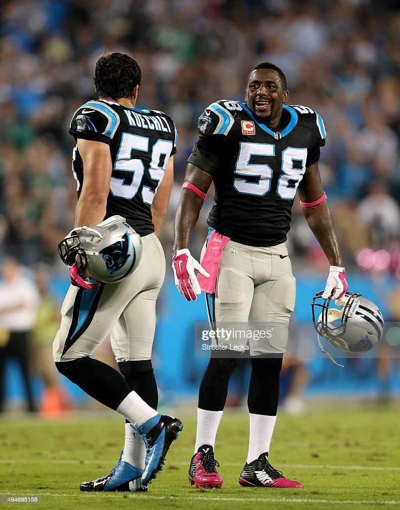 Teammates Thomas Davis and Luke Kuechly of the Carolina Panthers talk during a break against the Philadelphia Eagles at Bank of America Stadium on...
