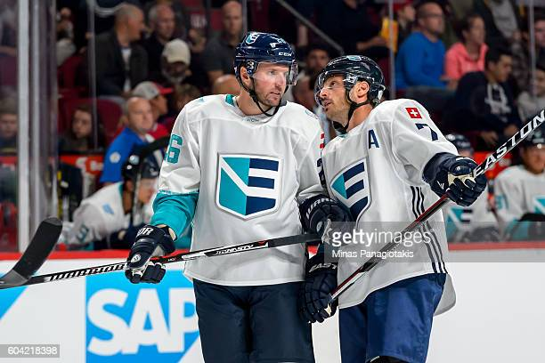 Teammates Thomas Vanek and Mark Streit of Team Europe speak during the pretournament World Cup of Hockey game against Team North America at the Bell...