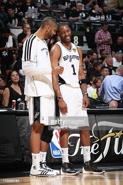 Teammates Tim Duncan and Tracy McGrady of the San Antonio Spurs while playing against the Miami Heat in Game Three of the 2013 NBA Finals on June 11...