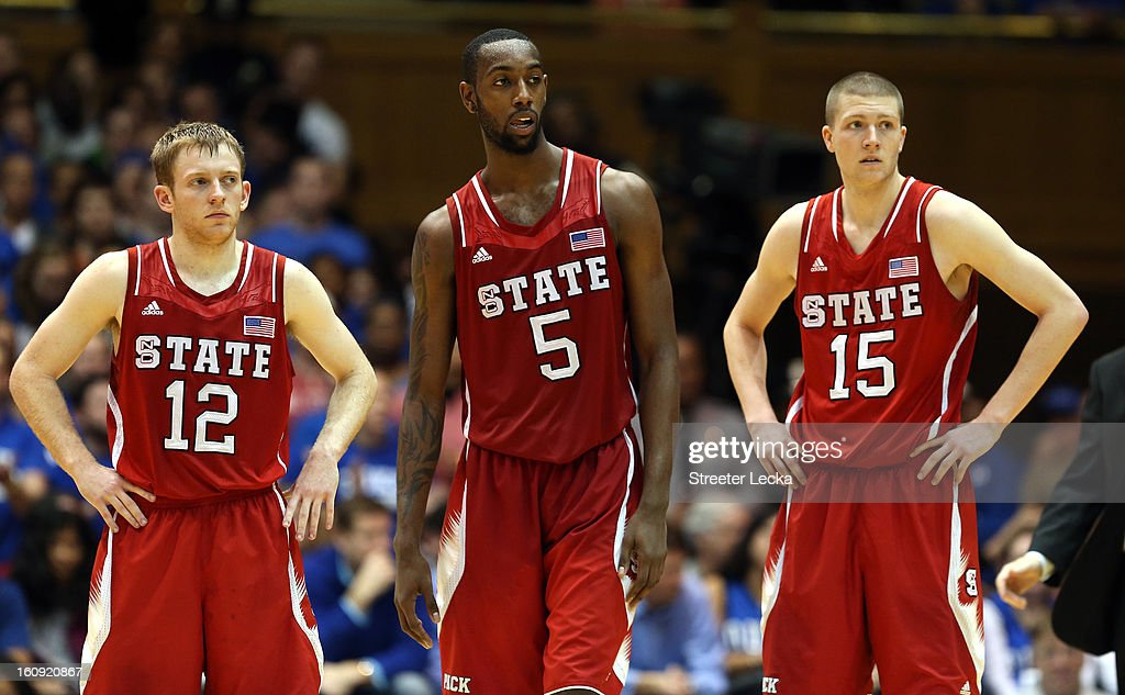Teammates Tyler Lewis #12, C.J. Leslie #5 and Scott Wood #15 of the North Carolina State Wolfpack react as they watch on against the Duke Blue Devils during their game at Cameron Indoor Stadium on February 7, 2013 in Durham, North Carolina.
