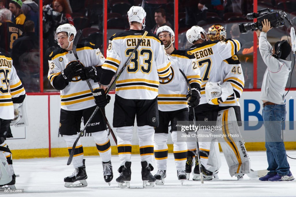 Teammates Zdeno Chara #33, Charlie McAvoy #73, Dominic Moore #28, Patrice Bergeron #37 and Tuukka Rask #40 of the Boston Bruins celebrate a win against the Ottawa Senators in Game One of the Eastern Conference First Round during the 2017 NHL Stanley Cup Playoffs at Canadian Tire Centre on April 12, 2017 in Ottawa, Ontario, Canada.