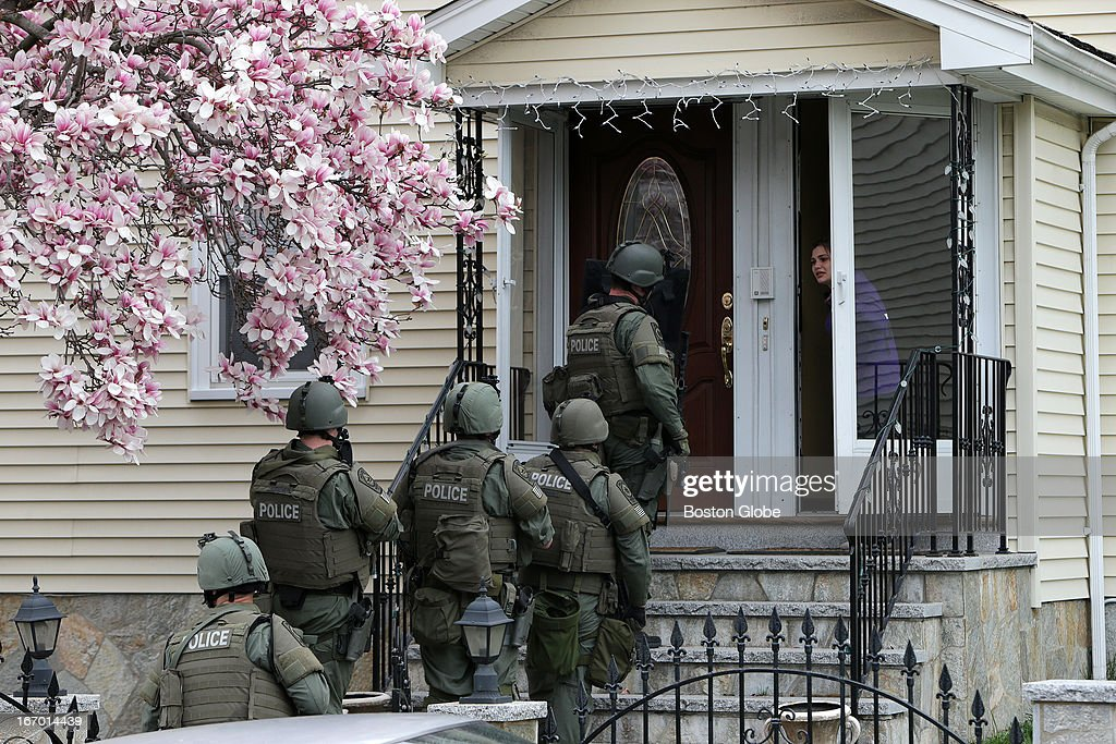 T teams conduct a house to house search in an area near last night's shootout during the ongoing manhunt for a suspect in the terrorist bombing of...