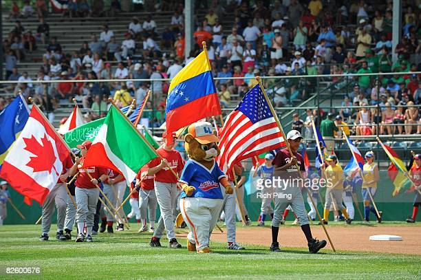Teams display their national flags before the game against the Waipio Little League team from Waipio Hawaii and the Matamoros Little League team from...