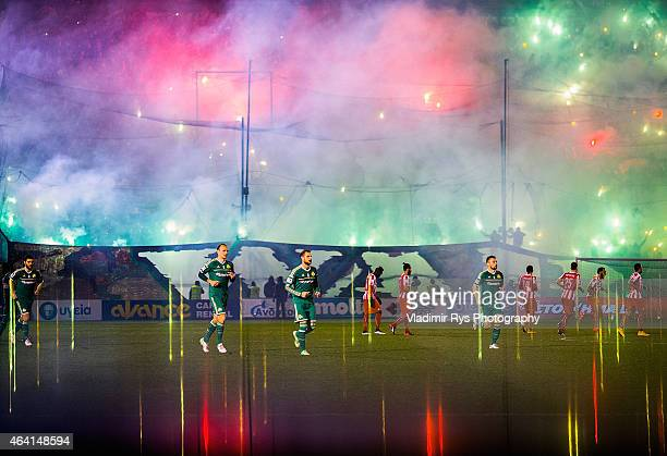 Teams enter the pitch ahead of the Superleague match between Panathinaikos FC and Olympiacos at Apostolos Nikolaidis Stadium on February 22 2015 in...