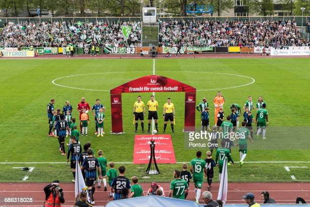 Teams enter the pitch during the Allsvenskan match between IK Sirius FK and Hammarby IF at Studenternas IP on May 21 2017 in Uppsala Sweden