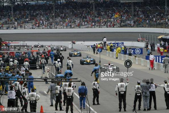 Teams enter the pits to retire from the United States F1 Grand Prix at the Indianapolis Motor Speedway on June 19 2005 in Indianapolis Indiana
