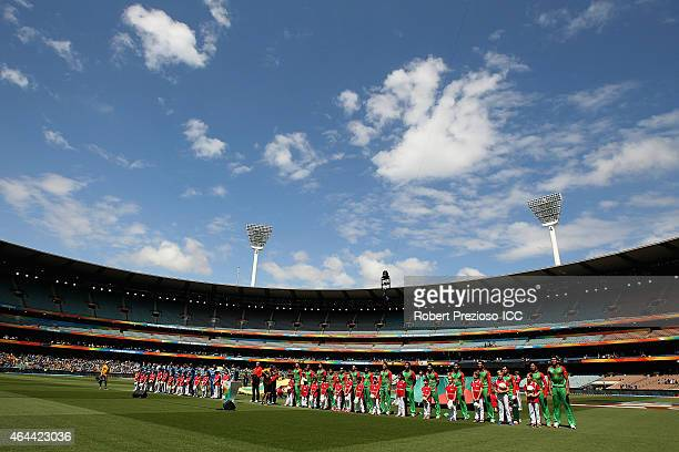 Teams line up for national anthems during the 2015 ICC Cricket World Cup match between Sri Lanka and Bangladesh at Melbourne Cricket Ground on...