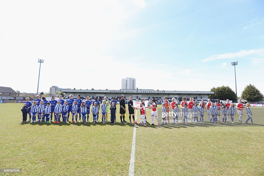 Teams line up prior to the WSL match between Arsenal Ladies and Birmingham City Ladies at Meadow Park on May 1, 2016 in Borehamwood, England.
