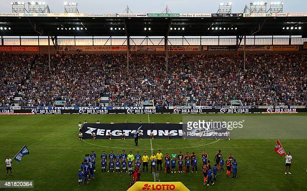 Teams of Magdeburg and Erfurt line up prior to the Third League match between 1 FC Magdeburg and FC Rot Weiss Erfurt at MDCCArena on July 24 2015 in...