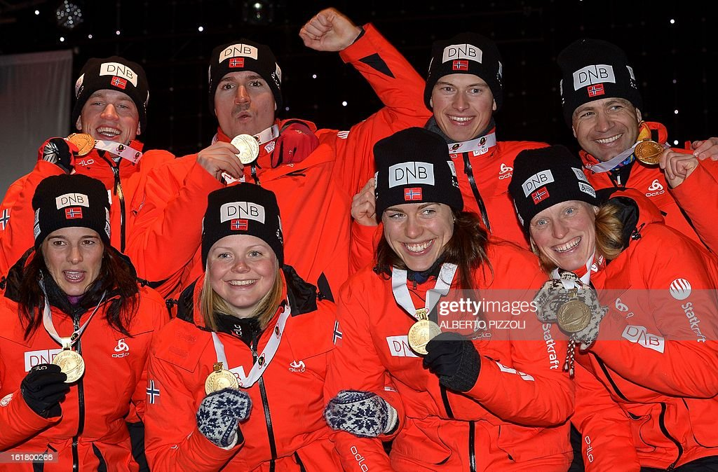 Teams of Norway (back row, L to R)Tarjei Boe, Emil Hegle Svendsen, Henrik L'Abee-Lund and Ole Einar Bjoerndalen, (front row L-R) Ann Kristin Aafedt Flatland, Hilde Fenne, Synnoeve Solemdal and Tora Berger celebrate their gold medals for the men 4x7,5 Km relay and women 4x6 Km relay as part of IBU Biathlon World Championships in Nove Mesto, Czech Republic, on February 16, 2013. AFP PHOTO / ALBERTO PIZZOLI