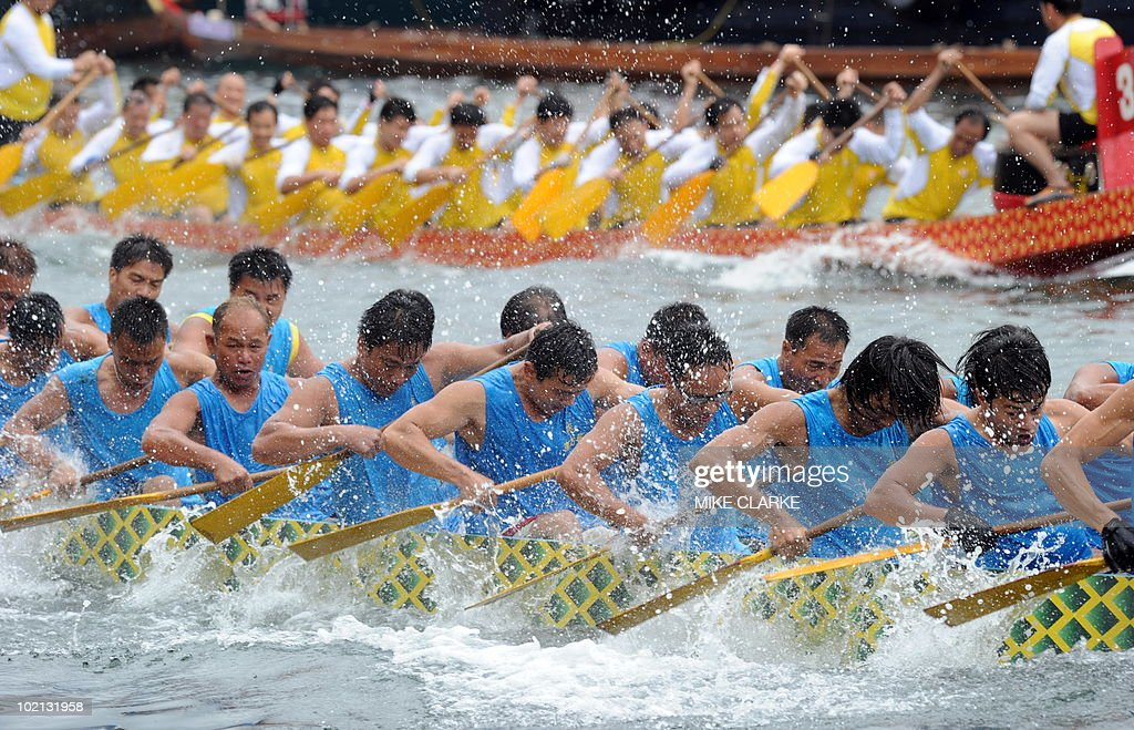 Teams participate in Dragon Boat races at Aberdeen harbour to celebrate the Dragon Boat Festival (Tuen Ng) in Hong Kong on June 16, 2010. The racing is held every year throughout the territory. According to legend national hero Qu Yuan died fighting for political reform. Townspeople tried to rescue him from drowning in the river and beat drums to scare the fish and now the tradition is continued with the Dragon Boat races. .