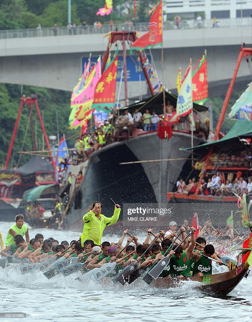 Teams participate in Dragon Boat races at Aberdeen harbour to celebrate the Dragon Boat Festival (Tuen Ng) in Hong Kong on June 16, 2010. The racing is held every year throughout the territory. According to legend national hero Qu Yuan died fighting for political reform. Townspeople tried to rescue him from drowning in the river and beat drums to scare the fish and now the tradition is continued with the Dragon Boat races. AFP PHOTO/MIKE CLARKE