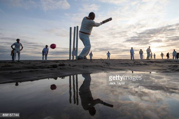 Teams play a cricket match on the Brambles sandbank at low tide on August 24 2017 in Hamble England The annual event sees Hamble's Royal Southern...