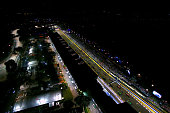 Teams prepare the cars on the grid before the formation lap of the Singapore Formula One Grand Prix at Marina Bay Street Circuit on September 21 2014...