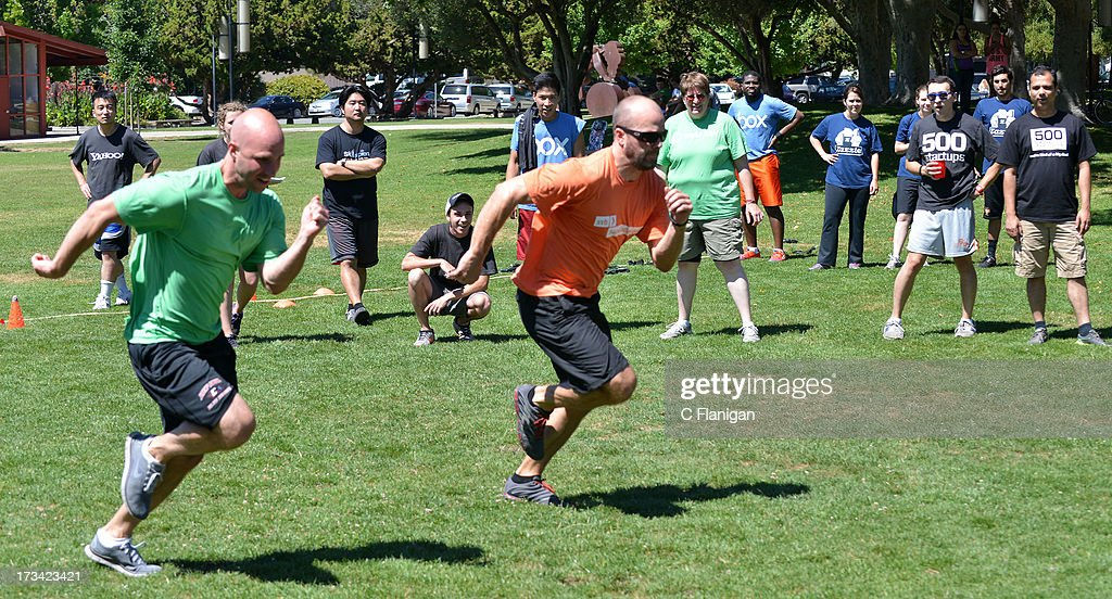 Teams race to decide winner of Duck Duck Goose competition during the Founder Institute's Silicon Valley Sports League event on July 13, 2013 in Palo Alto, California.