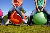 Teams racing on exercises balls