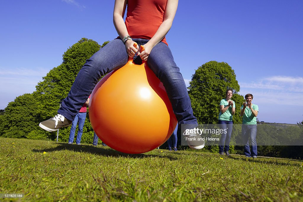 Teams racing on exercises balls : Stock Photo