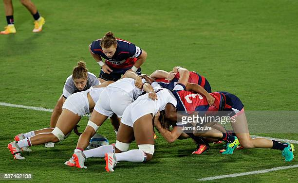 Teams scrum during the Women's Placing 78 Rugby Sevens match between France and United States of America on Day 3 of the Rio 2016 Olympic Games at...