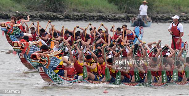 Teams take part in the annual Dragon Boat Festival in Taipei on June 12 2013 Some 234 teams from local and foreign countries took part in the annual...