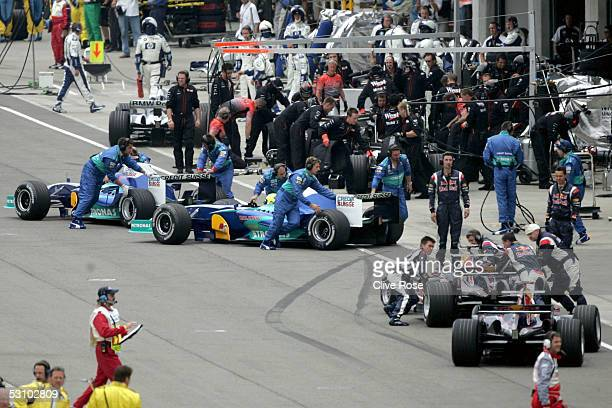 F1 teams using Michelin tires retire their cars at the start of the United States F1 Grand Prix at the Indianapolis Motor Speedway on June 19 2005 in...