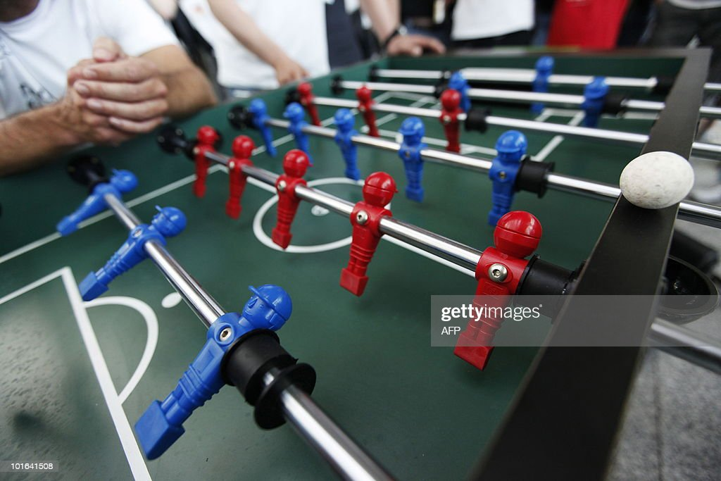 Teams wait for the second half of their match to start during a tabletop football tournament on June 5, 2010 in Berlin as the start of the FIFA 2010 World Cup in South Africa draws near. During the competition organised by a Berlin radio chain, 64 listeners of the chain formed 32 teams representing the countries which will take part in the World Cup.