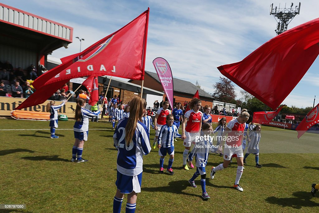 Teams walk out prior to the WSL match between Arsenal Ladies and Birmingham City Ladies at Meadow Park on May 1, 2016 in Borehamwood, England.