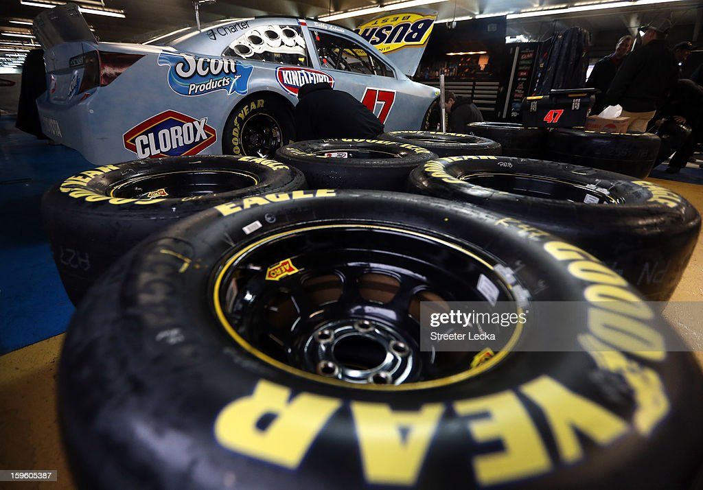 Teams work on cars in the garage during NASCAR Testing at Charlotte Motor Speedway at Charlotte Motor Speedway on January 17, 2013 in Charlotte, North Carolina.