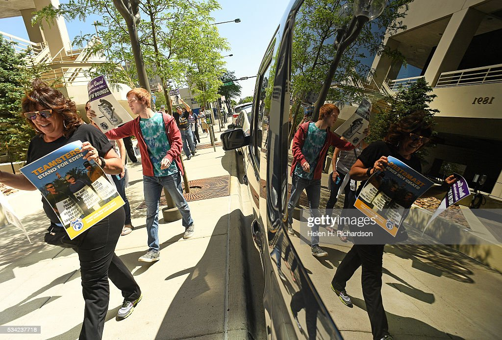 Teamsters and supporters join together as they hold signs to protest Molson Coors' annual shareholder meeting outside at 1881 Curtis street in Denver, Colorado on May 25, 2016 in Denver, Colorado. The protestors wanted to raise concerns about the planned closure of the award-winning MillerCoors brewery in Eden, N.C. The closure will impact 450 Teamster families in that state. The decision to close Eden was announced on September 14, just two days before the merger talks between SABMiller (LON: SAB) and AB/Inbev (NYSE: BUD) were formally disclosed to the public. Teamsters will warn shareholders of the likely anticompetitive effects of that decision and how it may be viewed by regulators.