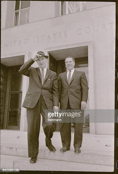 Teamster's President James R Hoffa and Harold J Gibbons Executive Vice President of the Teamster's Union shown as they leave the Federal Court House...