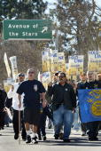 Teamsters union members turn off Century City California's Avenue of the Stars during a march by thousands of strikers and supporters to a rally at a...