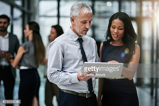 Teamwork and technology, indispensable tools for corporate productivity : Stock Photo