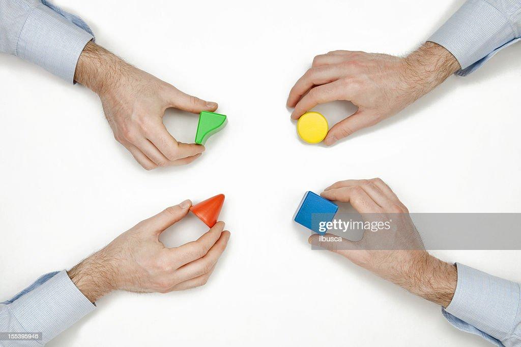 Teamwork concepts: adding different ideas : Stock Photo