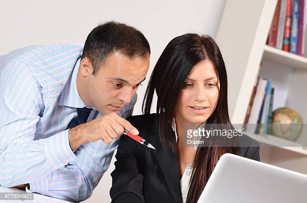 Teamwork in modern office with two young businessman and businesswoman