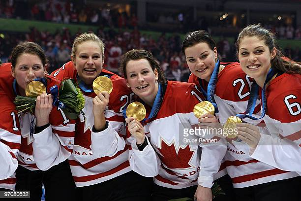 Tean Canada players celebrate with the gold medals won during the ice hockey women's gold medal game between Canada and USA on day 14 of the...