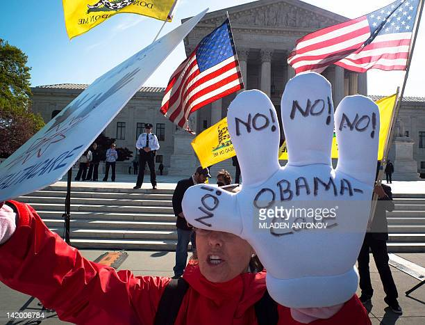 A TeaParty supporter protest outside the US Supreme Court on the third day of oral arguements over the constitutionality of the Patient Protection...