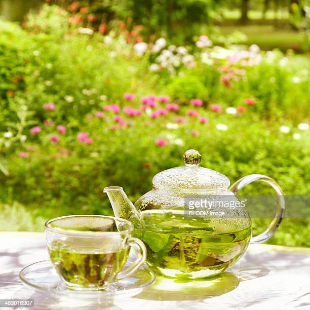 Teapot And Cup Containing Herbal Tea