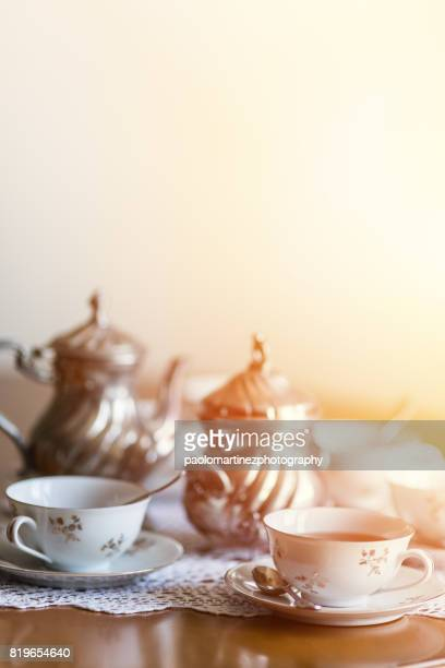 Teapot and cups on a wooden table