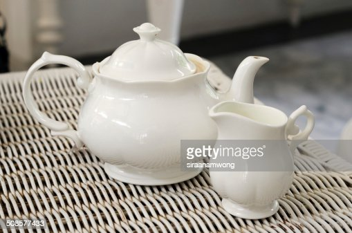 Teapot with little milk jar : Stock Photo