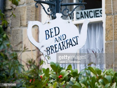 Teapot-shaped sign outside bed and breakfast.