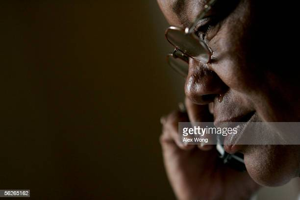 Tear comes out from the eyes of Hurricane Katrina evacuee Kathy Curry of New Orleans cries as she learns that her daughter cannot make it for...
