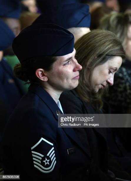 A tear falls down the cheek of a service woman during a memorial service for USAF crew members Captain Sean Ruane TSGT Dale Mathews SSGT Afton Ponce...