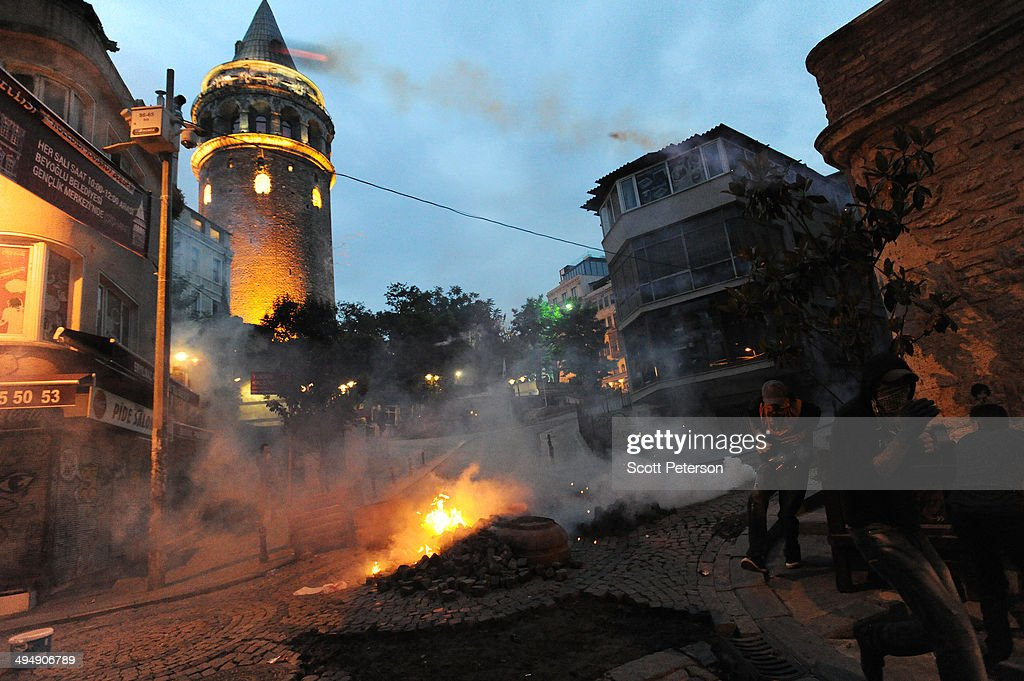 A tear gas canister fired by Turkish police flies through the air as protesters beneath Galata Tower mark the one-year anniversary of the Gezi Park protests on May 31, 2014 in Istanbul, Turkey. The original protest over the removal of trees to convert a downtown park into a shopping mall turned into a broader, month-long protest against the authoritarian rule of Turkish Prime Minister Recep Tayyip Erdogan, presenting the political biggest challenge to the PM and his ruling AK Party (AKP) after more than a decade in power.