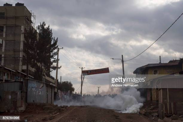 A tear gas canister lands in front of protestors in the Kawangware slum on August 10 2017 in Nairobi Kenya Tensions remain high as rumors of election...