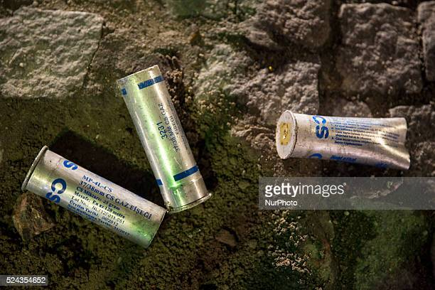 Tear gas canisters littered the streets in Istanbul on February 25 2014 after demonstrators clashed with police during a protest against government...