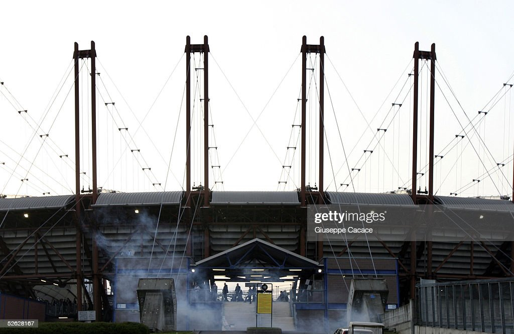 Tear gas is fired into the Juventus fans sector before the UEFA Champions League quarterfinal second leg between Juventus and Liverpool at the Delle...