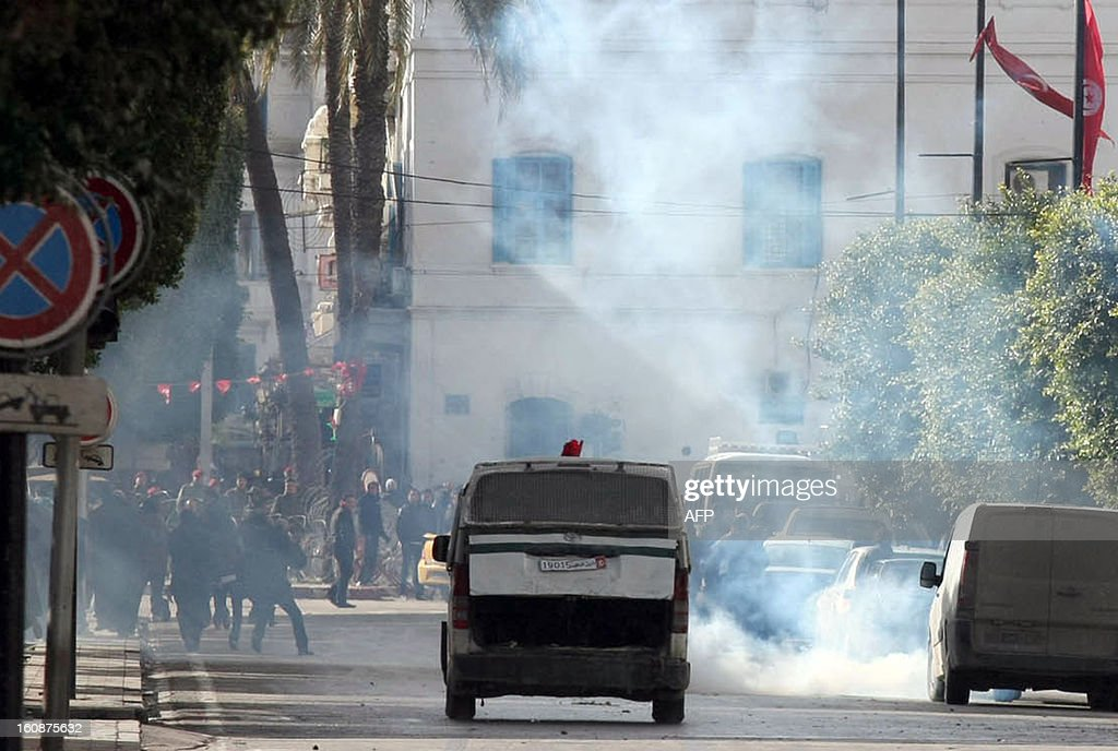 Tear gas smoke fired by Tunisian police to disperse demonstrators is seen during a rally outside the Interior Ministry in Tunis, on February 7, 2013. Police was deployed in force in the Tunisian capital amid fears the murder of the 48-year-old opposition figure could reignite nationwide violence, as the ruling Islamists broke ranks over how to defuse the crisis. AFP PHOTO / KHALIL