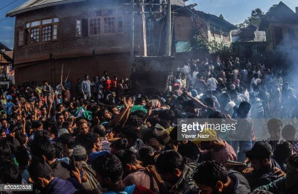 Tear gassed by Indian government forces Kashmiri Muslims carry the body of Tanveer Ahmad Pala a civilian killed by Indian military forces during his...