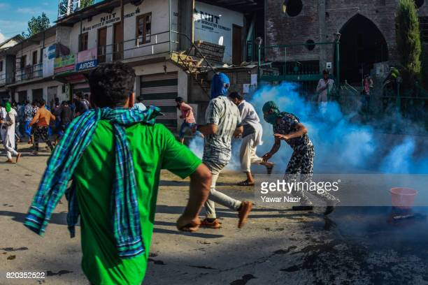 Tear gassed by Indian government forces Kashmiri Muslims run towards safer places as they were carrying the body of Tanveer Ahmad Pala a civilian...